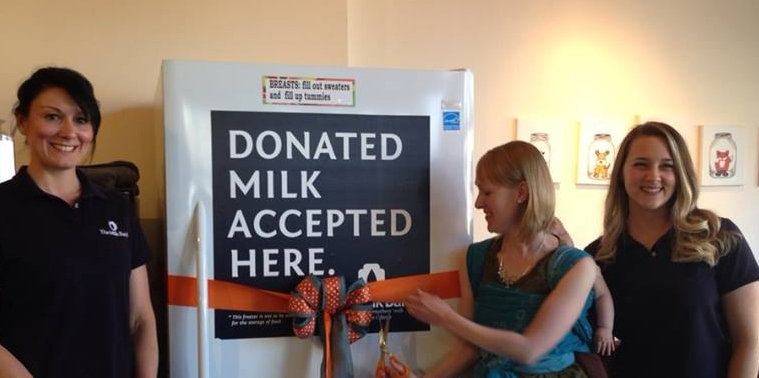 Ribbon cutting at the opening of the AmberSky Milk Depot